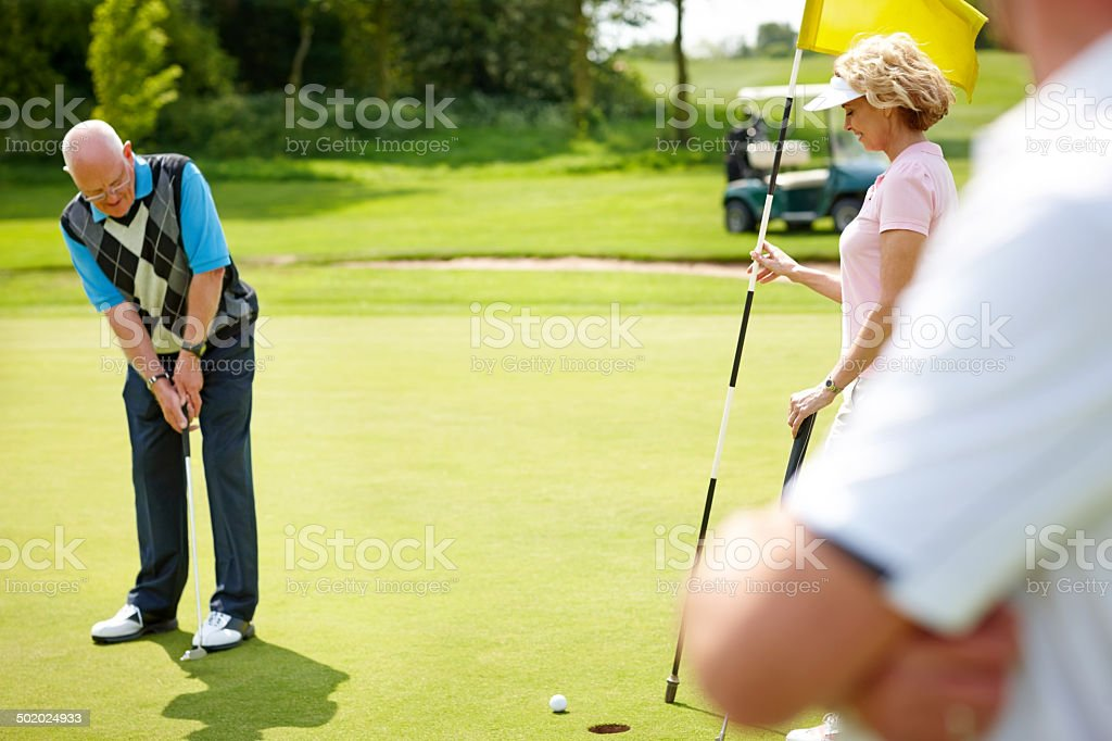 Golfers having fun on the green stock photo