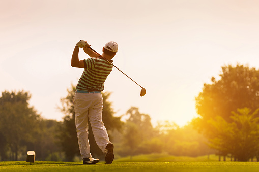 istock Golfers hit sweeping golf course in the summer 853943448