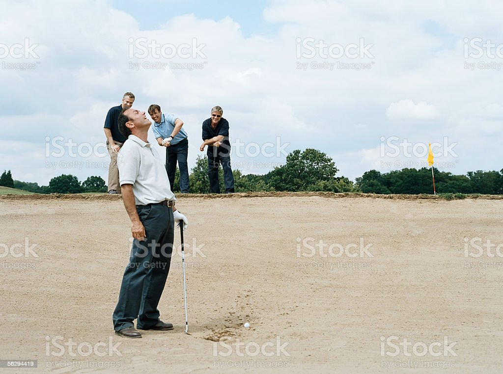 Golfers laughing royalty-free stock photo
