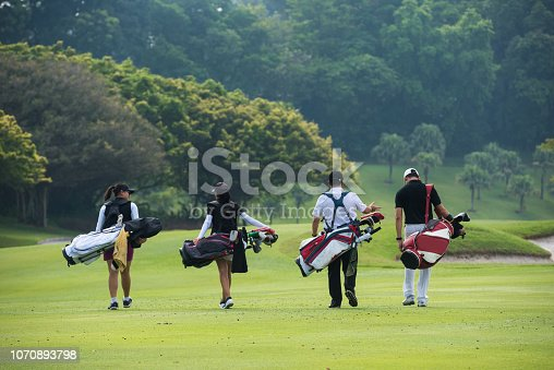 Golfers walking to the next hole