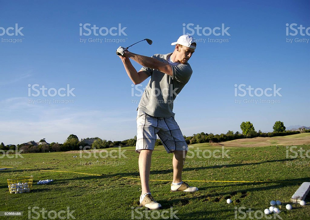 Golfing at the range. stock photo