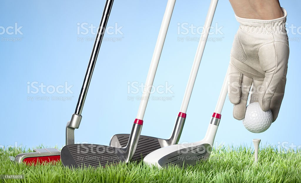 Golfing concept series - Teeing up royalty-free stock photo