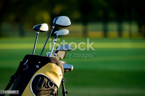 A set of new golf clubs on a beautiful golf course