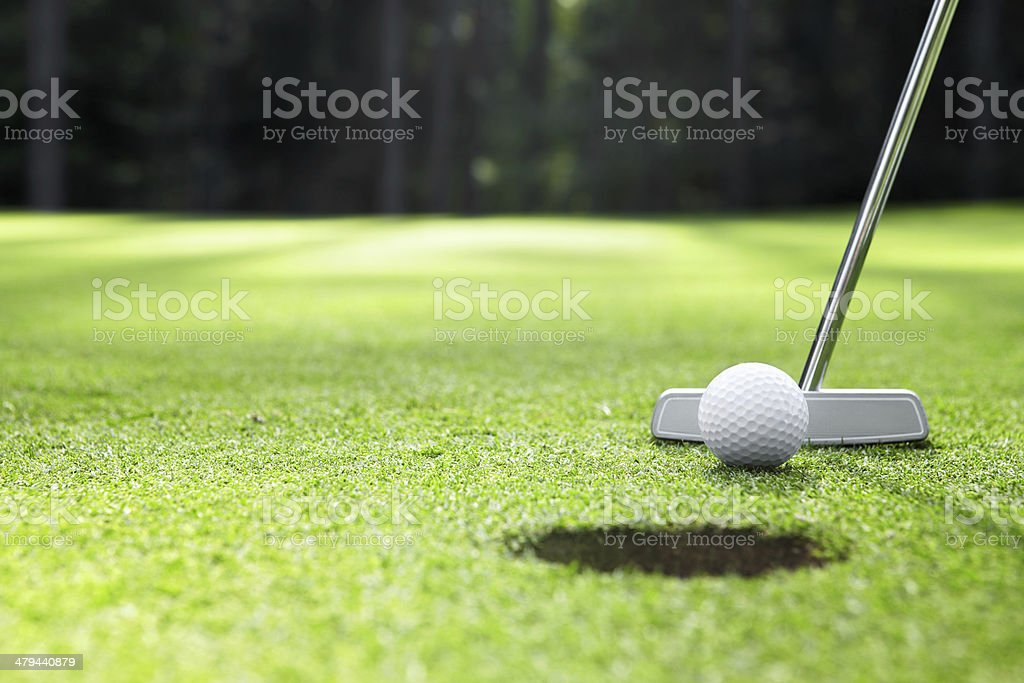 Golfing The ball at the hole on the golf course Close-up Stock Photo