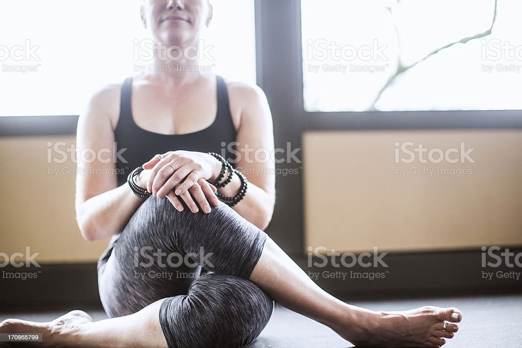 Gomukhasana in Yoga Studio royalty-free stock photo