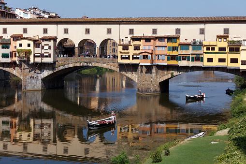 Gondola against Ponte Vecchio in Florence, Italy