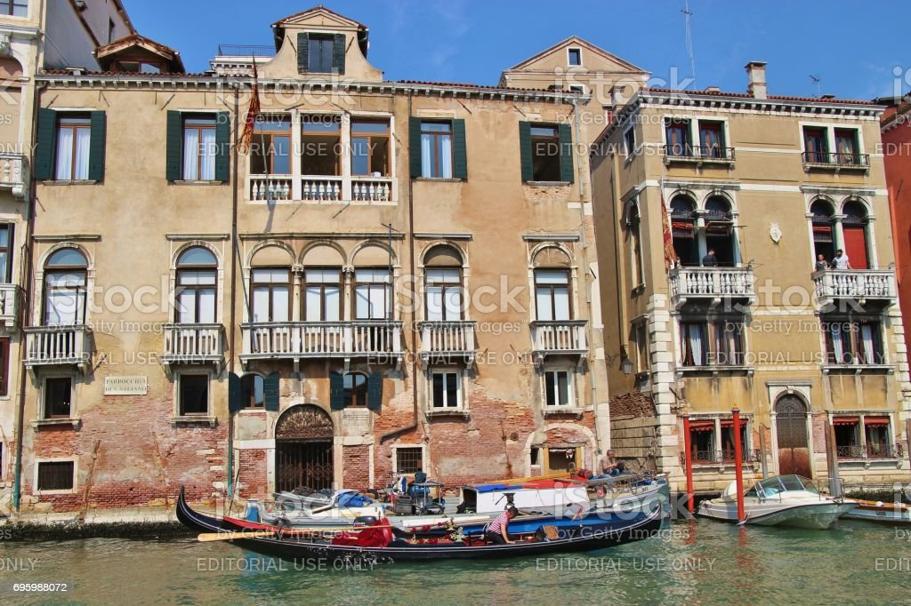 Gondola and buildings on the Grand Canal, Venice, Italy. stock photo