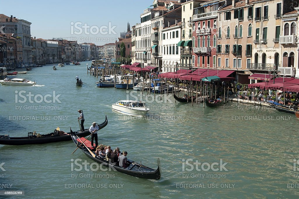 Gondola and water taxis on Grand Canal in Venice royalty-free stock photo