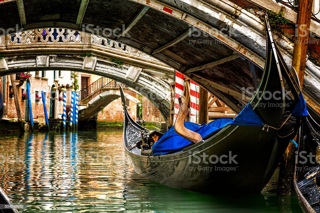 Gondola in a Venice canal stock photo