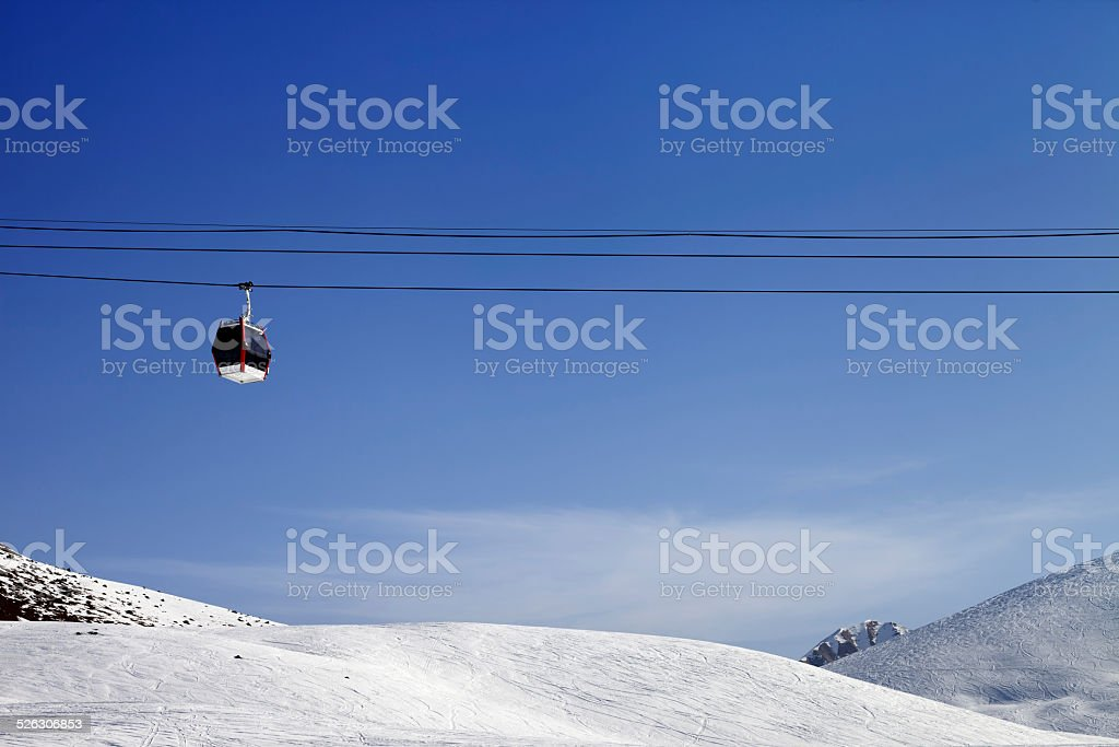 Gondola lift and ski slope at sun day stock photo