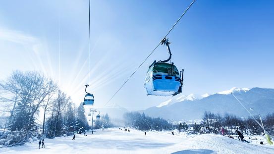 Gondola lift at ski resort in winter. Pirin Mountains. Ropeway station in Bansko
