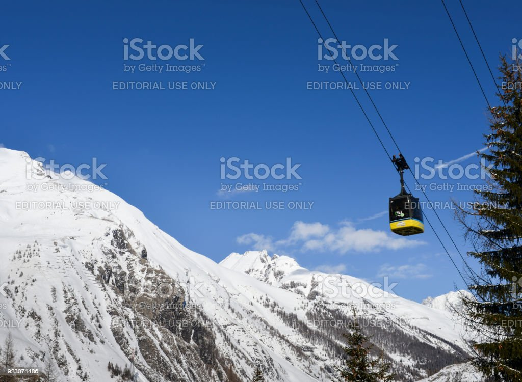 Gondola lift at ski resort in winter with copy space - La Thuile, Valle d'Aosta, Italy
