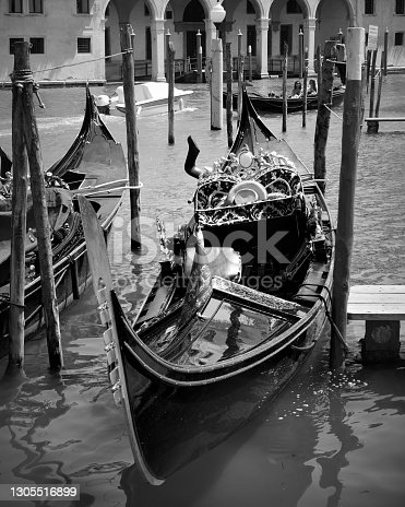 Gondola on the Grand Canal in Venice, Italy. Black and white photography, venetian cityscape