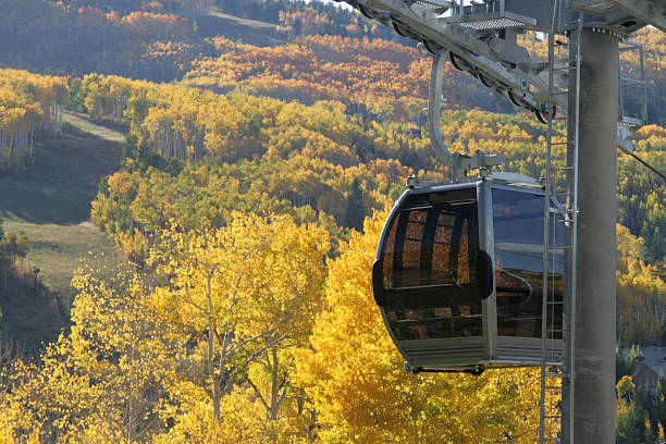 Gondola Beaver Creek Gondola with autumn colors in the background. vail colorado stock pictures, royalty-free photos & images