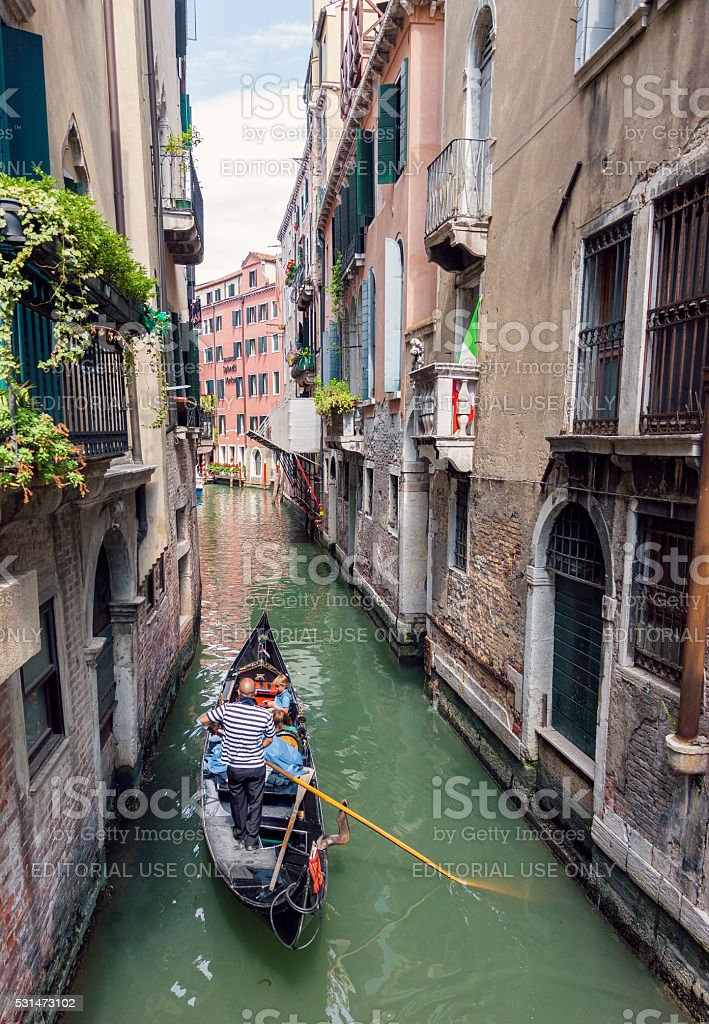 Gondola sailing in Venice stock photo