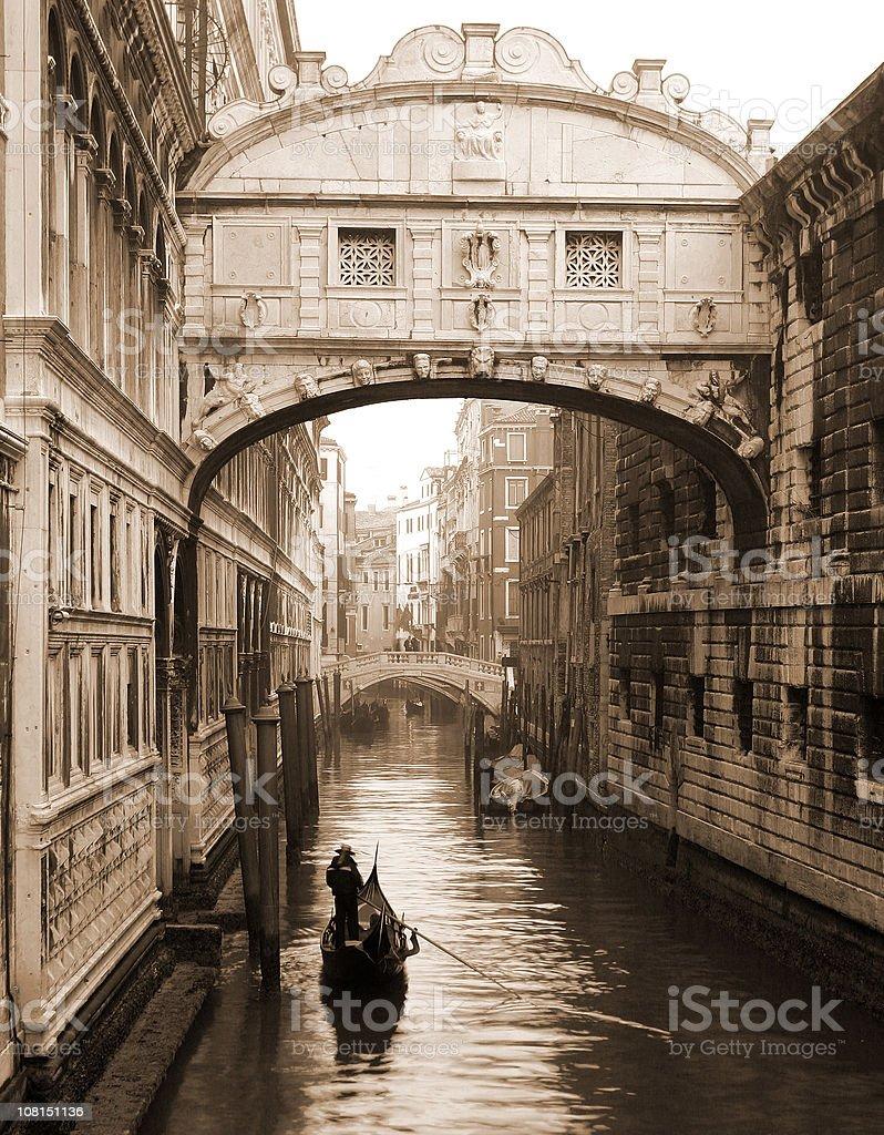 Gondola Under Bridge of Sighs, Sepia Toned royalty-free stock photo