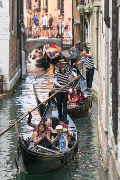 Gondola with gondolier and tourists stock photo