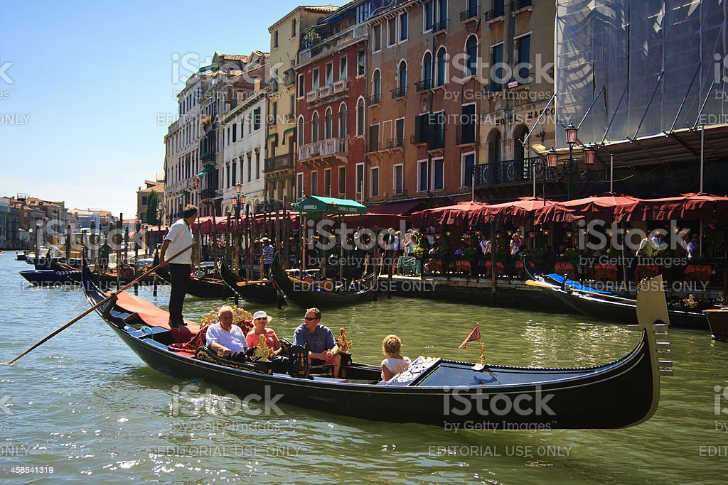 Gondola with tourists at Grand Canal, Venice, Italy royalty-free stock photo