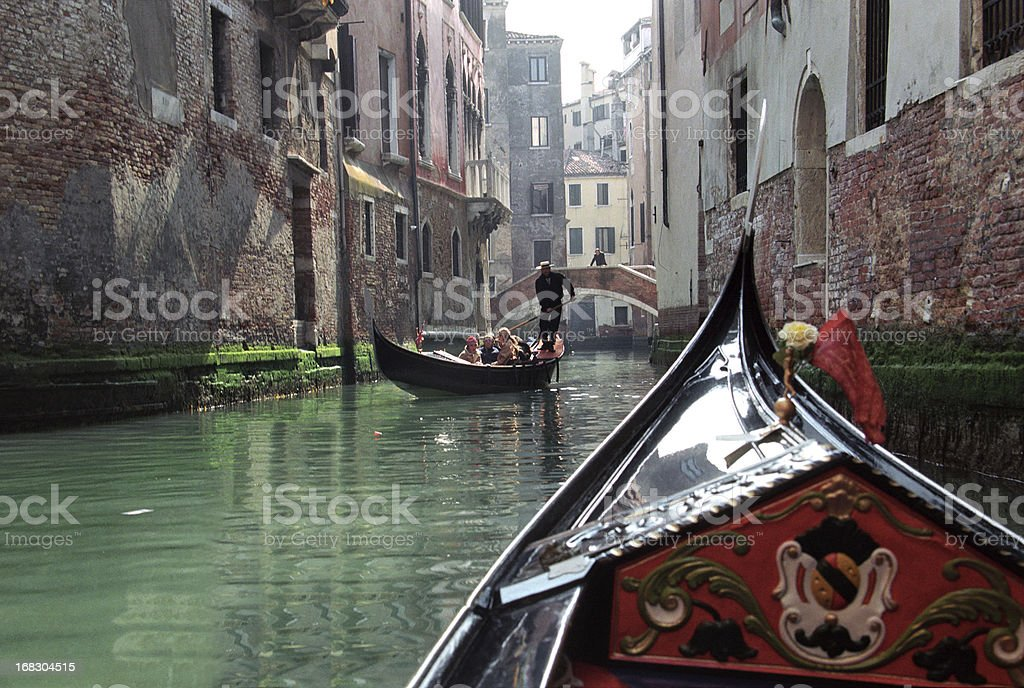 Gondola with tourists in Venice royalty-free stock photo