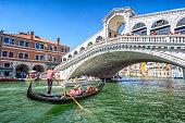 istock Gondola with tourists on Gran Canal with Rialto Bridge, Venice 1262957521