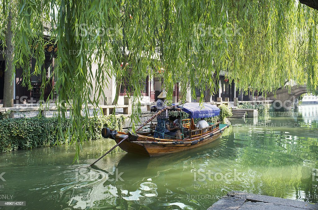 Gondola-like boat on canal in Chinese water city royalty-free stock photo