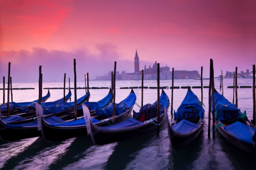 Gondolas after sunset in Venice