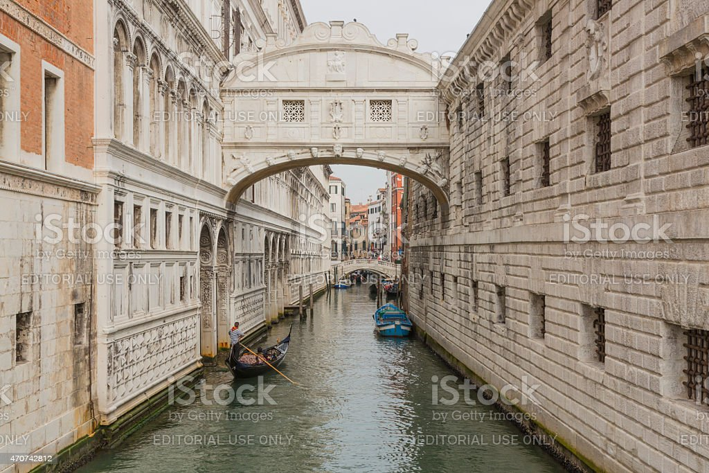 Gondolas and boats under the Bridge of Sighs in Venice stock photo