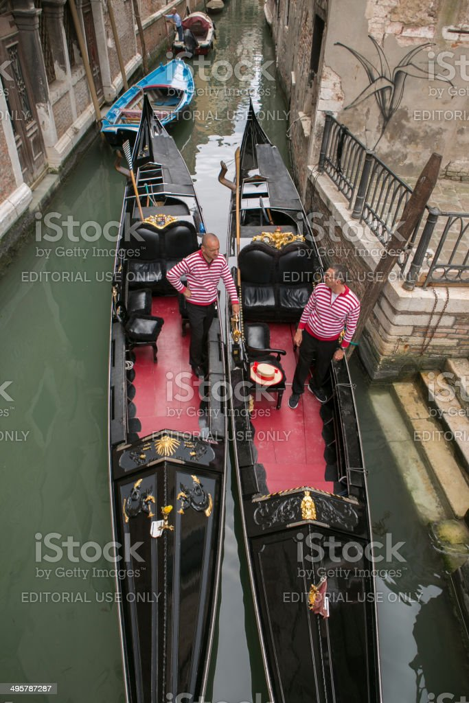 gondolas at water channel of venice italy stock photo