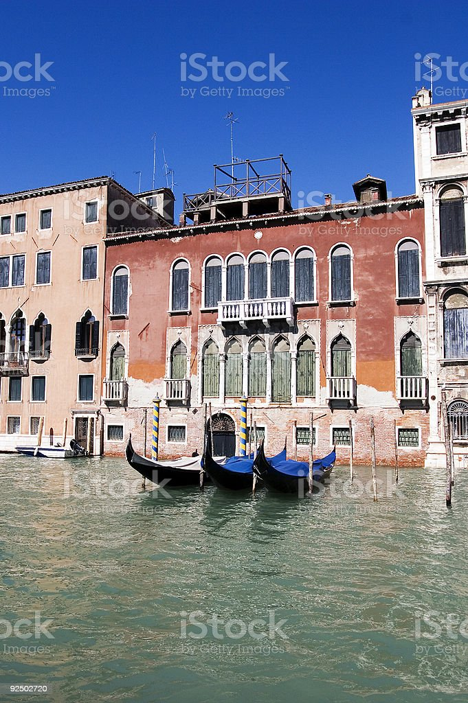Gondolas by buildings royalty-free stock photo