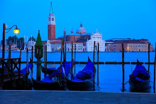Gondolas illuminated at evening - San Marco, San Giorgio Maggiore, Venice