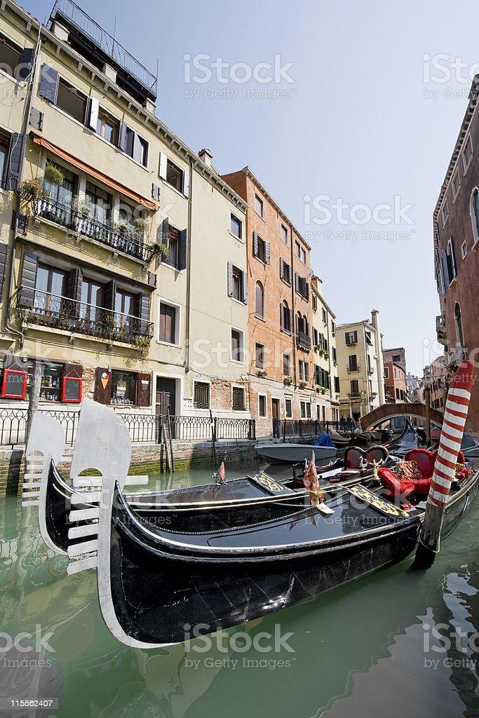 Gondolas in a small canal of Venice, Italy royalty-free stock photo