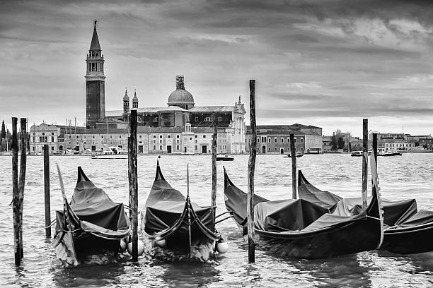 Gondolas in front of San Giorgio Maggiore b&w stock photo