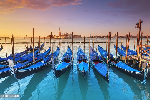 The Venetian Lagoon with docked gondolas.