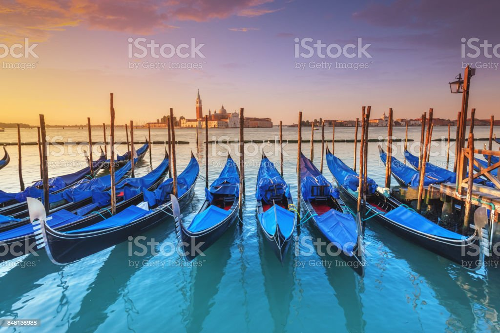 Gondolas in Venice at sunrise stock photo
