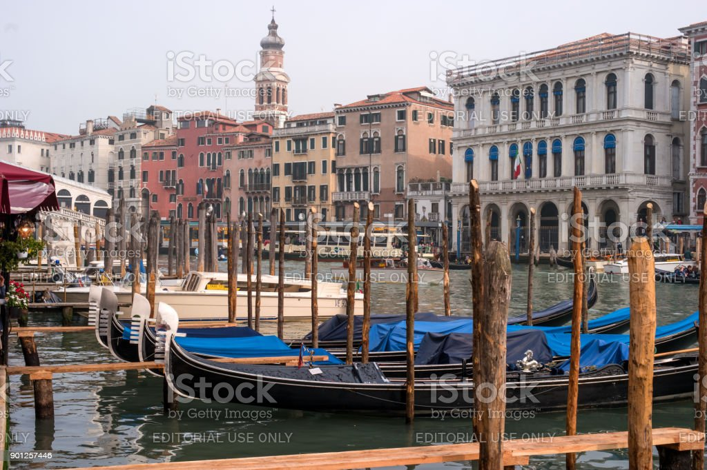 Gondolas in Venice. The gondolas are moored at the mooring posts. stock photo