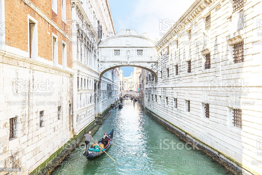 Gondolas is passing over Bridge of Sighs in Venice, Italy stock photo