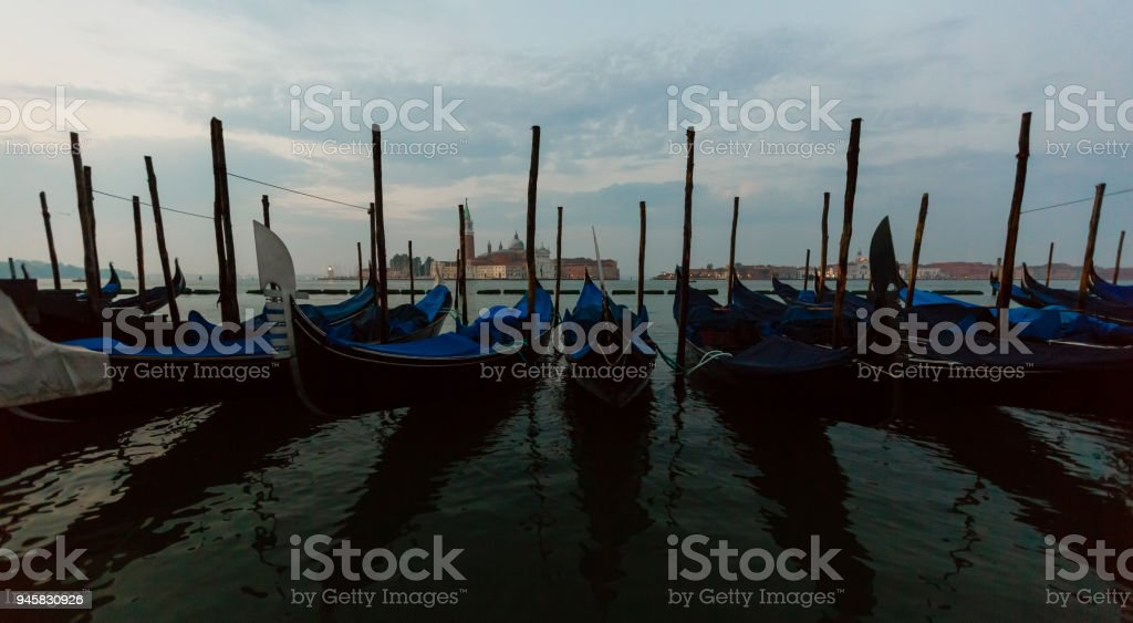 Gondolas moored on the Grand Canal, Venice, Italy stock photo