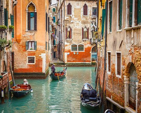 Gondolas on narrow canal in Venice, Italy