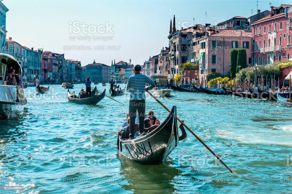 Gondolas Tourists Colorful Grand Canal Bridge Venice Italy stock photo