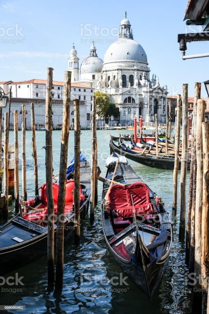 Gondolas with Saint Mary of Health Venice Italy stock photo