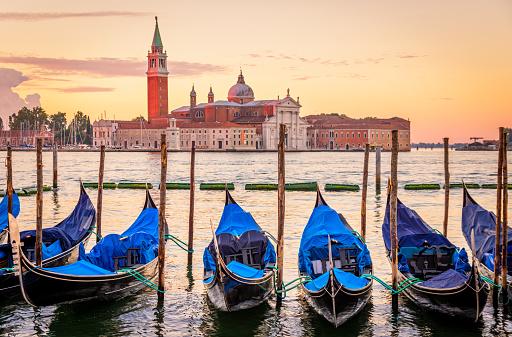 Gondolas with San Giorgio Maggiore at sunrise, Venice, Italy