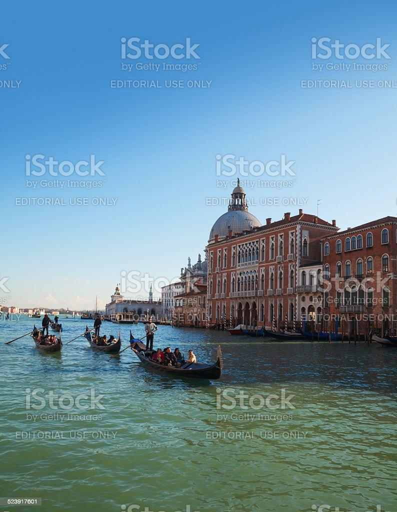 Gondolas with tourists at Grand canal in Venice stock photo