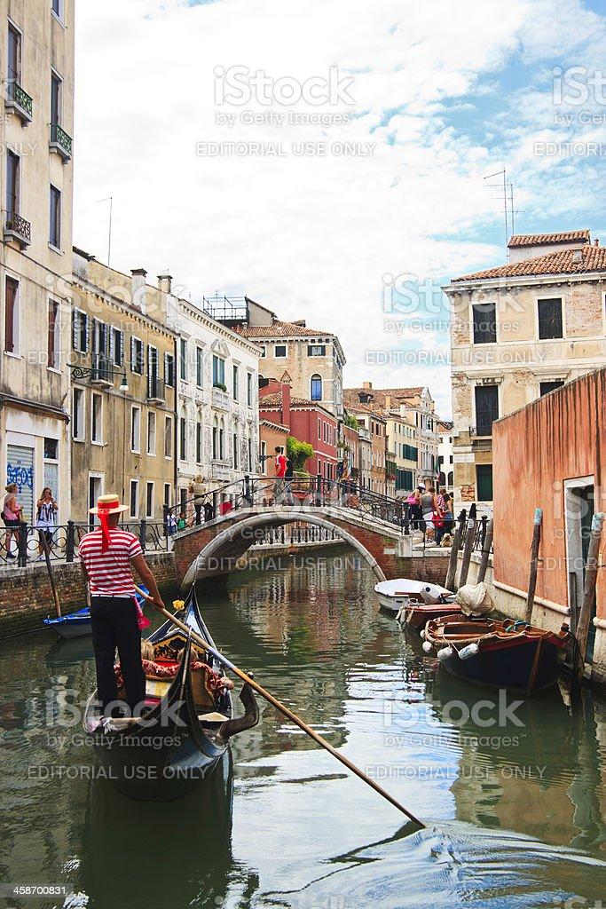 Gondolier on gondola in canal, Venice, Italy royalty-free stock photo