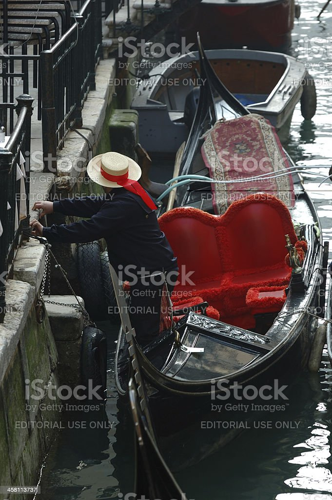 Gondolier preparing boat for taking tourists on Venice canals stock photo