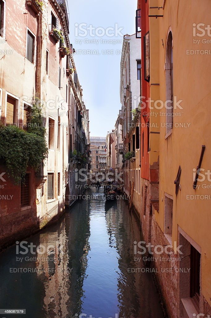 Gondolier rides gondola on the canals of Venice royalty-free stock photo