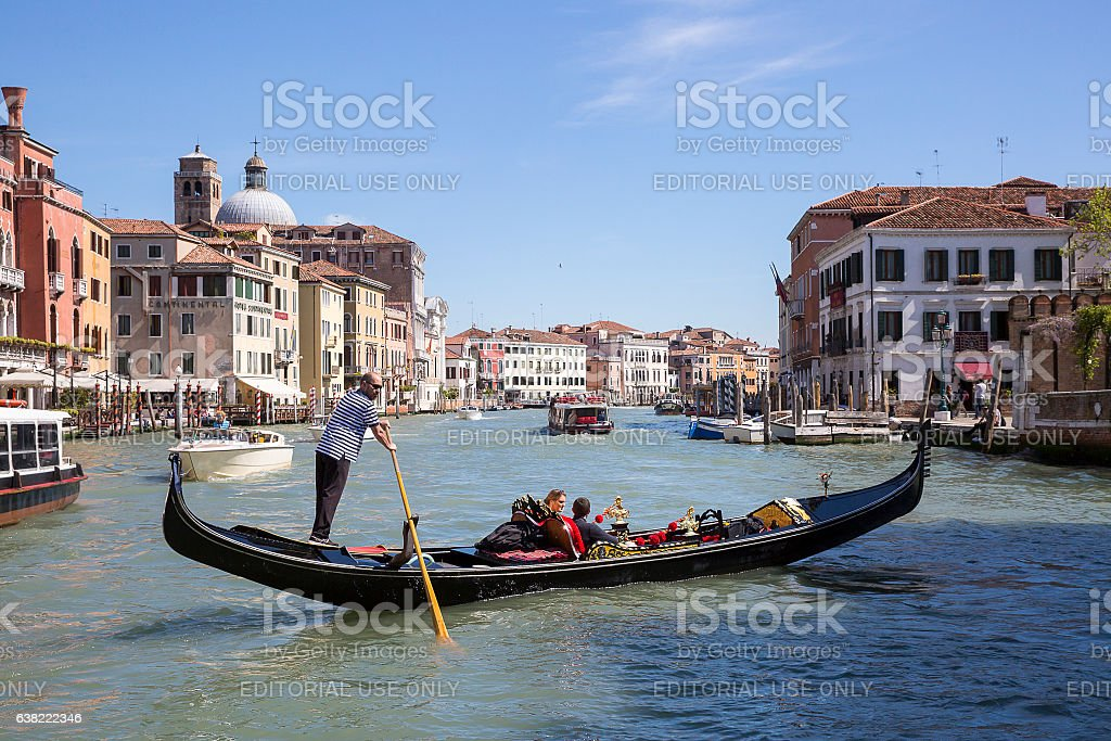 Gondolier rowing on Grand Canal, Venice, Italy stock photo