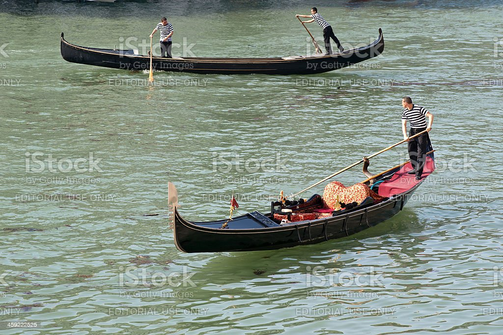 Gondolieres with their gondolas in a canal of Venice, Italy royalty-free stock photo