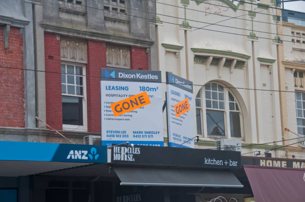 Gone banner pasted on top of lease ads of office space above ANZ bank in South area of Melbourne Australia stock photo