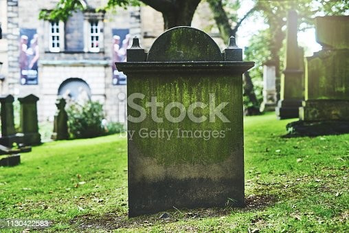 Shot of a gravestone in a cemetery