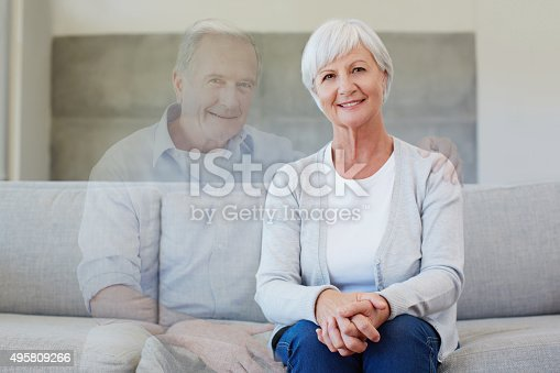 Portrait of a happy senior woman sitting on the sofa next to an apparition of her deceased husbandhttp://195.154.178.81/DATA/i_collage/pu/shoots/805858.jpg